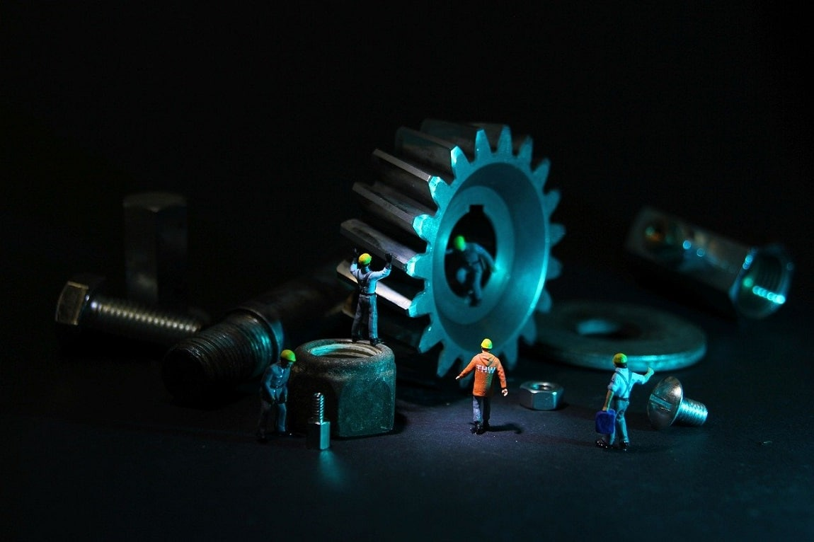 new technology in mechanical engineering showing gear with workers